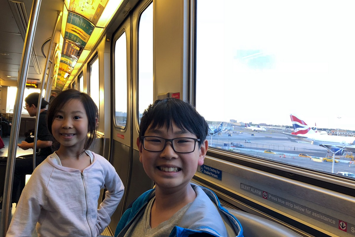 Family taking Air Train to JFK