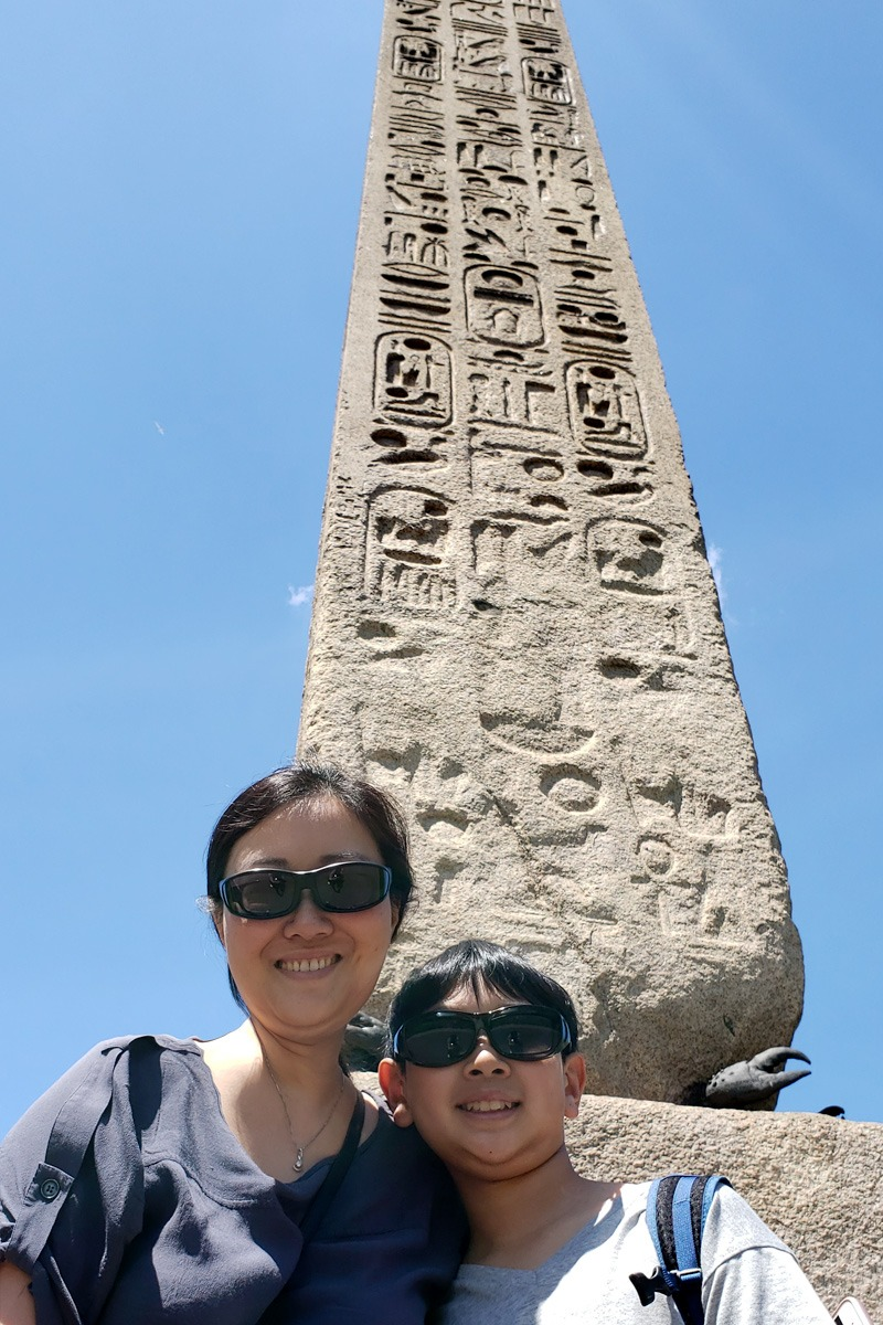 Family travels to central park obelisk